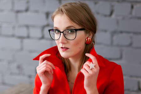 Retro style woman in red dress wearing glasses Stock Photo