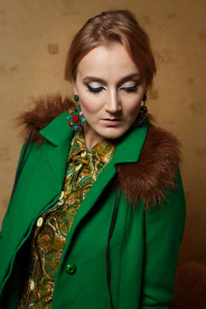1970s vintage lady wearing green jacket Stock Photo