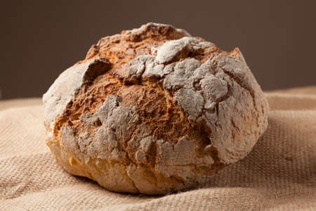 Close up view of a Portuguese traditional baked bread on brown background. Stock Photo