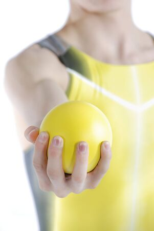 Athlete holding shot put on a white background. Stock Photo - 7405131