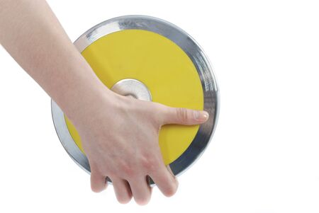 Hand holding a discus on a white background. photo