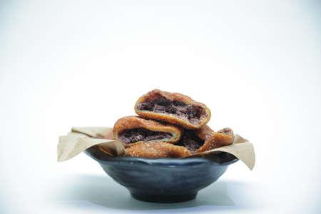 Korean traditional snacks, Red Bean Glutinous Rice Ball Doughnuts on a black bowl