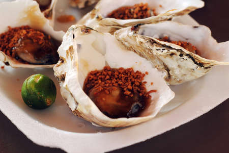 the east coast: oyster with lime on east coast food court Stock Photo