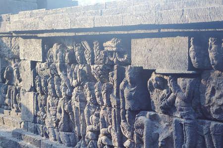 borobudur: wall of embossment in borobudur