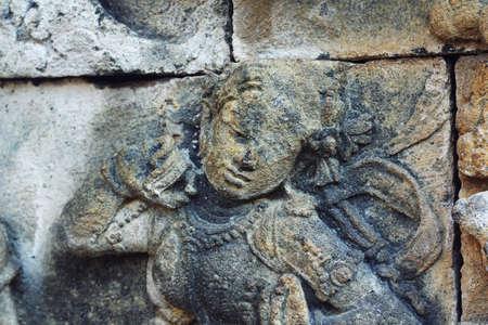 craving: female figure craving on stone wall of Borobudur Stock Photo