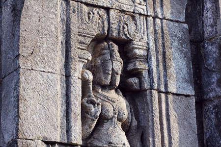 embossment: broken sculpture of a buddha