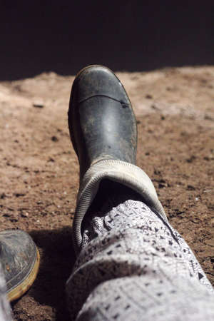 cave exploring: people wearing galosh overshoe Stock Photo