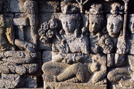 crave: buddha relief on the wall of borobudur temple
