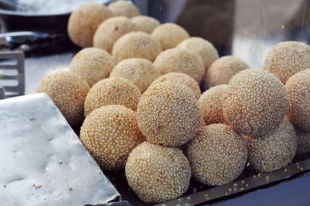 sesame street: fried sticky rice ball covered with white sesame seed