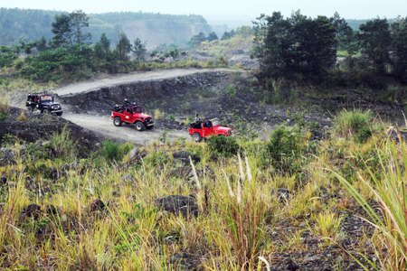 red jeep running at mount merapi