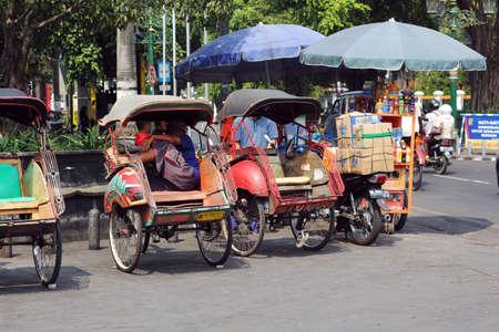 YOGYAKARTA: cycle rickshaws at yogyakarta street Editorial
