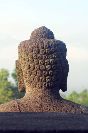 back of head: back head of a buddha statue on the top of borobudur