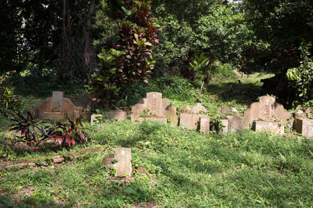 tombstone at Bukit Brown Cemetery in Singapore Editorial