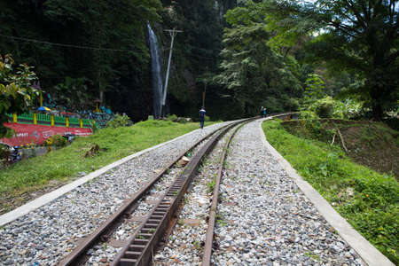 Railway track by a waterfall Editorial