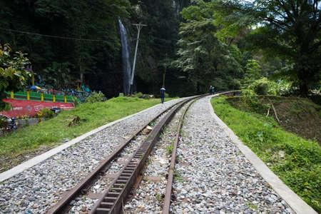 Railway track by a waterfall Standard-Bild - 104131302