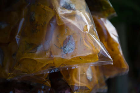 Dried fish snack in packages