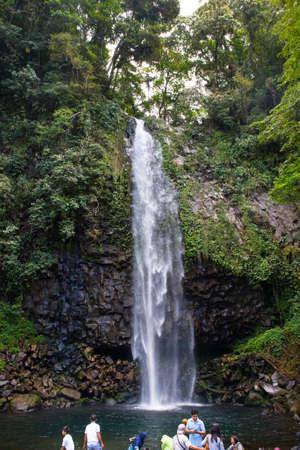 People relaxing by a waterfall Standard-Bild - 104131308