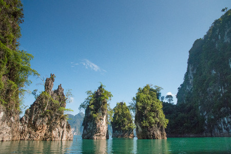 Beautiful mountains in lake river Ratchaprapha Dam at Khao Sok National Park, Surat Thani Province, Thailand. photo