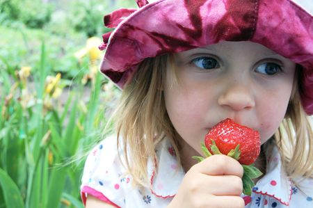 eating a strawberry Stock Photo - 4264728