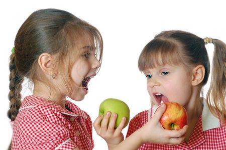 poco: niñas con manzanas Foto de archivo