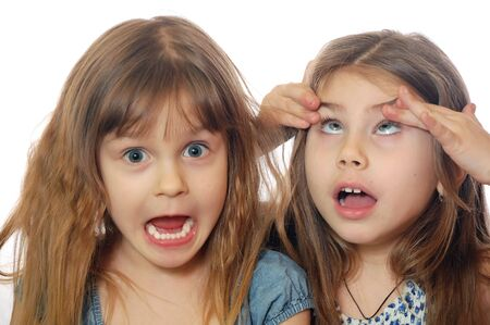 aversion: girls making faces Stock Photo