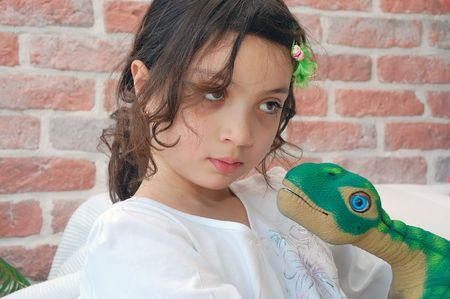 embracement: Girl With A Dino Stock Photo