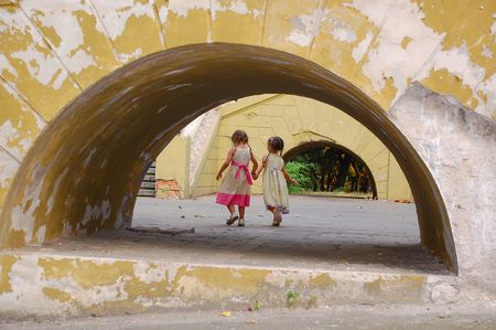 wreckage: Girls In The Grunge Archway Stock Photo