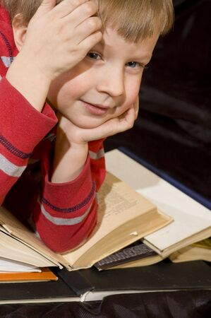 homestudy: boy and books Stock Photo
