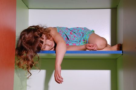 curly hair child: sleeping little girl Stock Photo