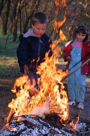 kids near the fire photo