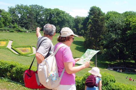 tourist family reading a map photo