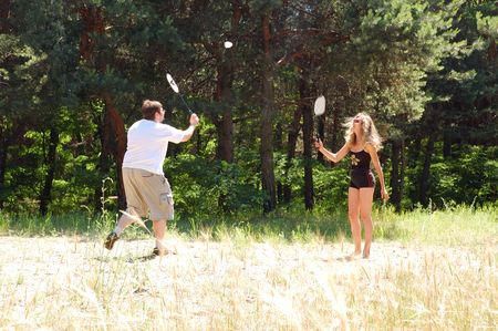couple playing badminton photo
