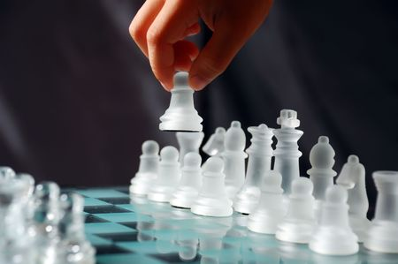 gamesmanship: childs hand doing first move with a pawn