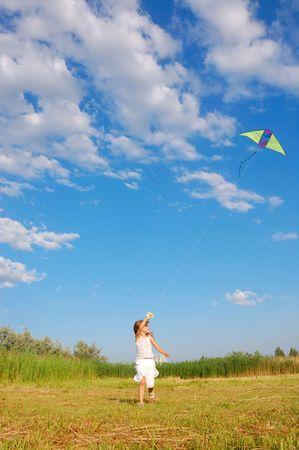 凧の飛行少女 写真素材