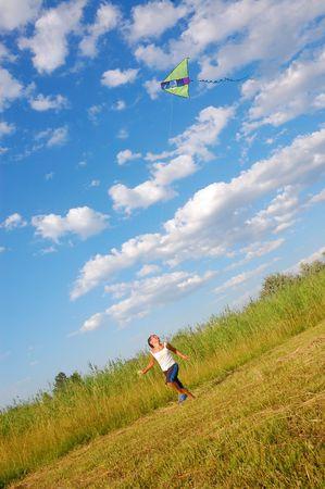 凧の飛行少年 写真素材
