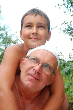 senior father with his youngest son outdoor photo