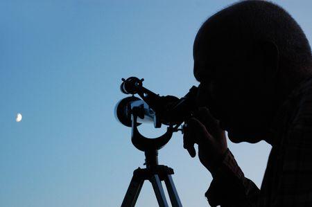 男と月 写真素材