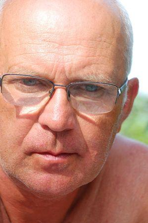 portrait of handsome senior man wearing glasses in metal frame photo