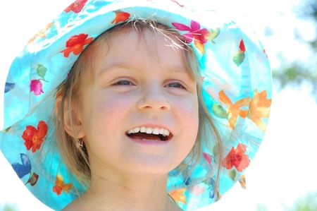 adorable little girl happy smiling on a sunny summer day photo