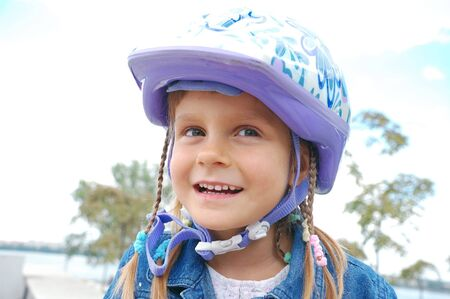blader: happy 5 year old girl wearing a protective helmet