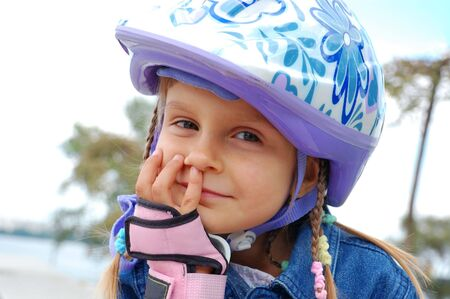 blader: cute 5 years old smiling child wearing a protective helmet Stock Photo