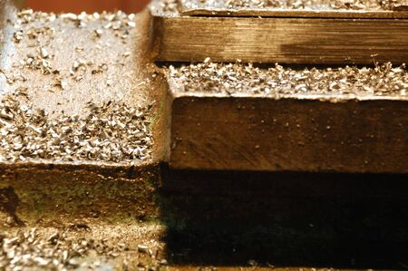 filings: golden metal construction covered with filings