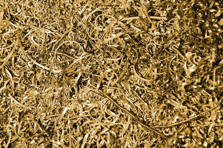 filings: background of many small metal golden pieces of metal Stock Photo