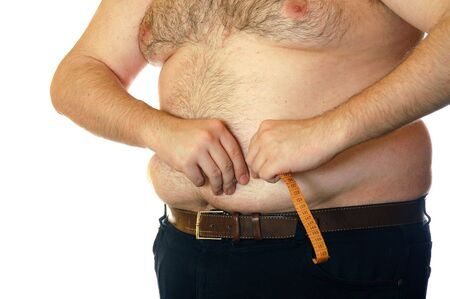 hairy arms: fat man measuring his belly against the white background Stock Photo