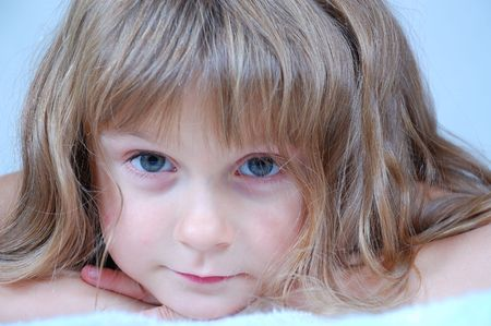 serenety: close-up portait of a cute pretty little girl  Stock Photo