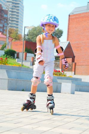 smiling 5 year old girl going on her in-line skates  photo