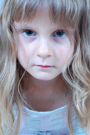 ilness: portrait of a little upset girl looking sick Stock Photo