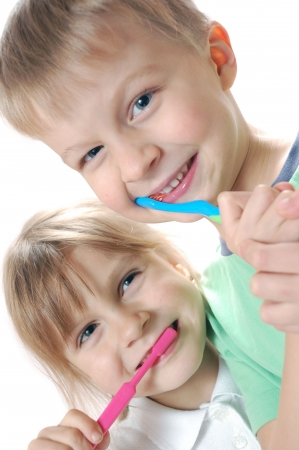 two children cleaning  teeth over white background photo
