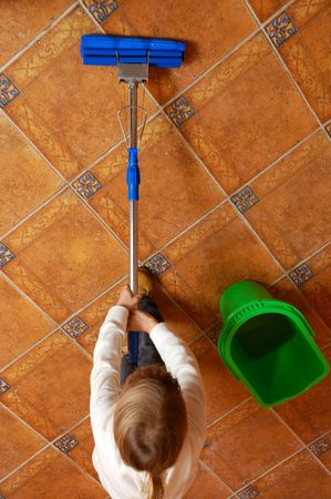 little girl washing the floor with swap Stock Photo - 5968944