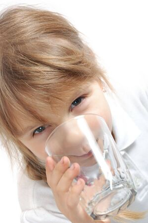 Child drinking water. Isolated photo